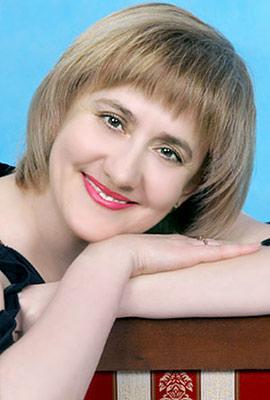 elegant, dreamy, smiling and cute Rusian woman living in  Kazan